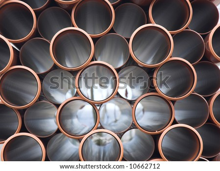 Brown PVC pipes - stock photo