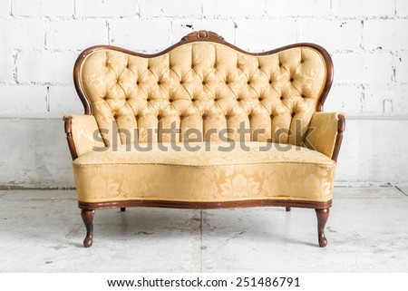 Brown Retro classical style sofa couch in vintage room  - stock photo
