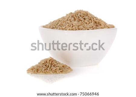 Brown rice in a bowl isolated on a white background - stock photo
