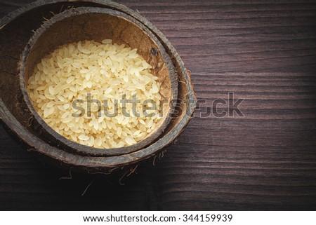 brown rice in coconut - stock photo