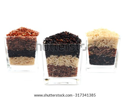 Brown rice in glass - stock photo