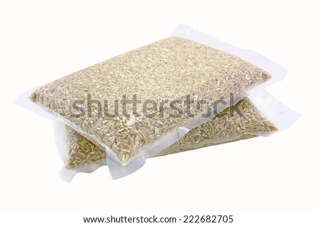 Brown rice in vacuum bag isolated on white background - stock photo