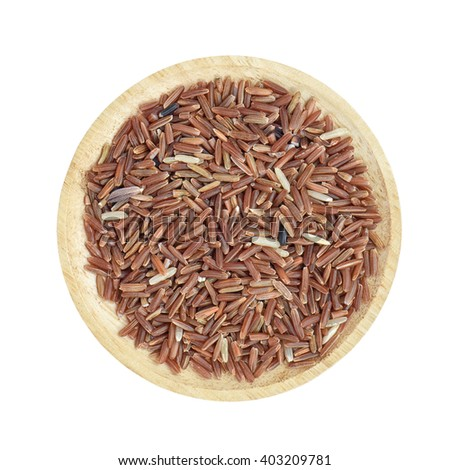 Brown rice in wooden bowl on white background