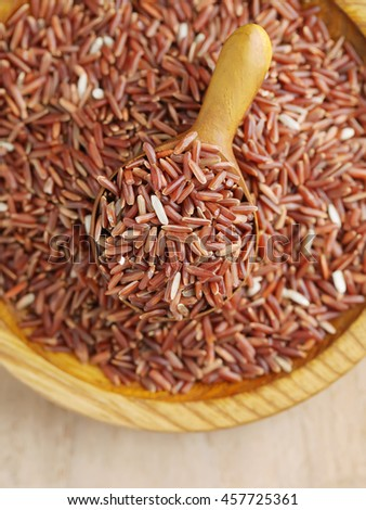 Brown rice in wooden spoon,close-up,with copy space.
