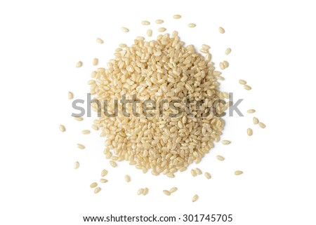 brown rice on the white background, top view - stock photo