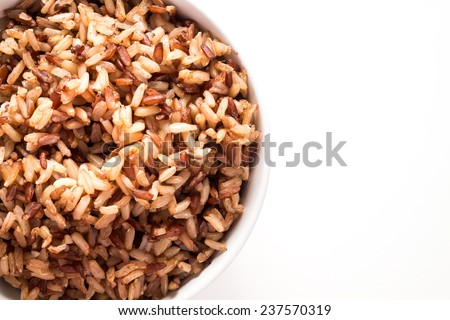 Brown rice on white isolated