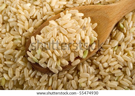 brown rice over the spoon - stock photo