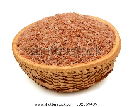 brown rice uncooked in a heap isolated on a white background - stock photo
