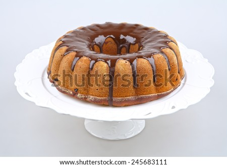 brown ring cake with chocolate frosting