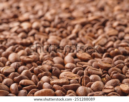 Brown roast coffee beans closeup background, selective focus - stock photo