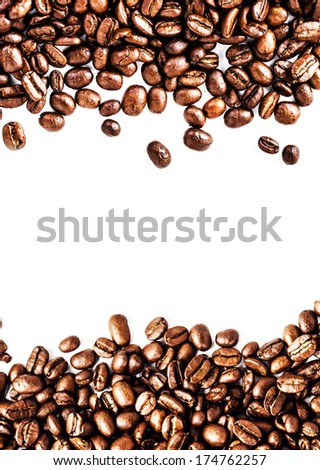 Brown roasted coffee beans isolated on white Coffee beans frame. background.  Arabic roasting coffee ingredient of hot beverage.  Fragrant fried coffee beans close up.