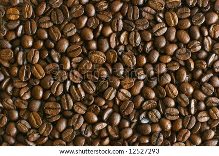 Brown roasted coffee beans laying on table texture - stock photo