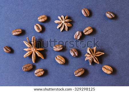 Brown roasted coffee beans, seed with spices. Espresso dark, aroma, black caffeine drink. Closeup isolated energy mocha, cappuccino ingredient.  - stock photo