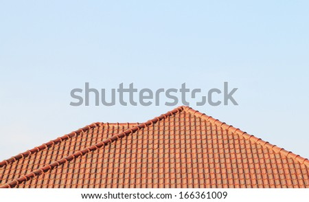 Brown roof, blue sky background - stock photo