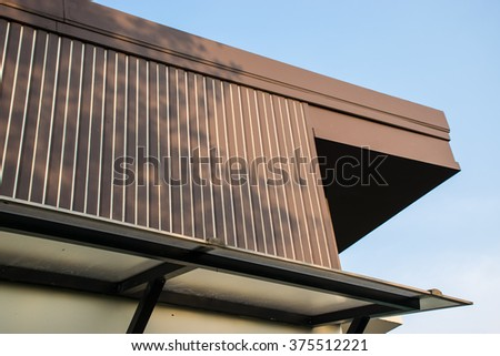 Brown roof on car park dock - stock photo