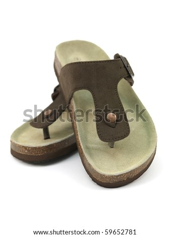 Brown sandals isolated against a white background - stock photo