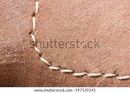 Brown sewed leather texture. - stock photo