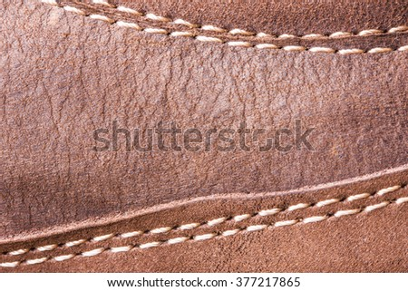 Brown sewed suede texture. - stock photo