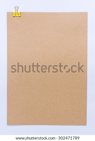 Brown sheet of paper for notes and paper clip - stock photo