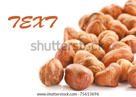 Brown shelled hazelnuts isolated on white background - stock photo