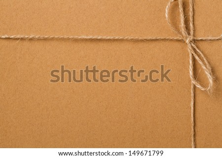 Brown shipping parcel tied with twine - stock photo
