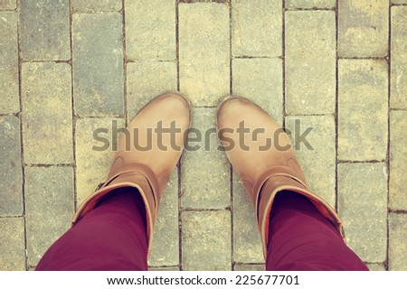 Brown shoes from aerial view on concrete block pavement.  Top view, feeling between choose, choice. - stock photo
