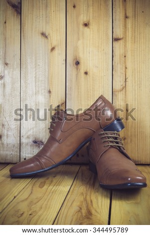 Brown shoes on wooden background