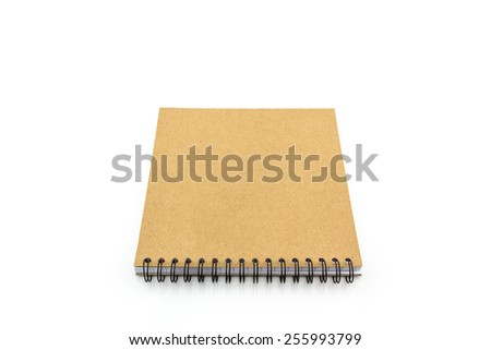 Brown sketch book on white background. - stock photo