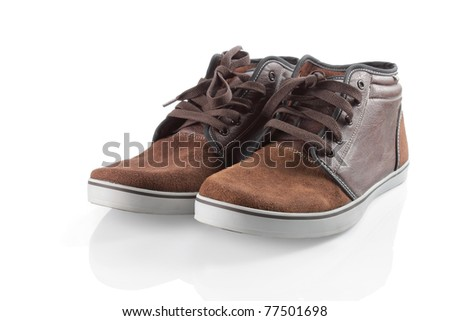 brown sneakers isolated over white background - stock photo