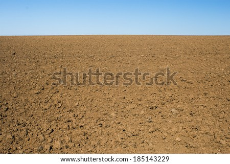 Brown soil land and blue sky landscape - stock photo