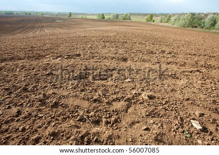 Brown soil of an agricultural field - stock photo