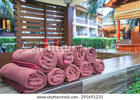 brown spa towels roll pile for customer service in pool - stock photo