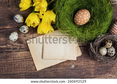 Brown speckled eggs and easter card on a wooden background - stock photo