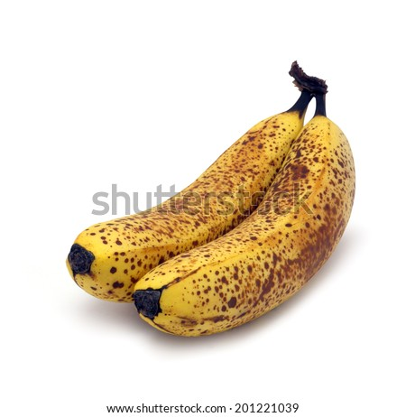 Brown spotted bananas that are just right for baking isolated on white - stock photo