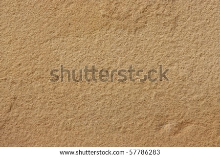 Brown stone wall texture - stock photo