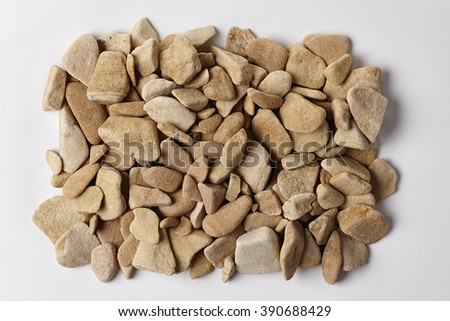 Brown Stones Texture Background. Top View of a Pile of River Stones or Rocks Surface. Close Up Macro View with Copy Space for Text or image