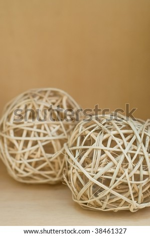 Brown straw balls on the wood shelf - stock photo