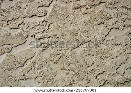 Brown stucco wall suitable for backgrounds - stock photo