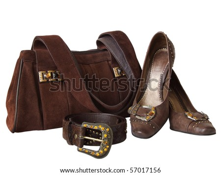 Brown suede bag, leather shoes and belt, decorated by yellow and orange artificial gems, isolated on a white background - stock photo