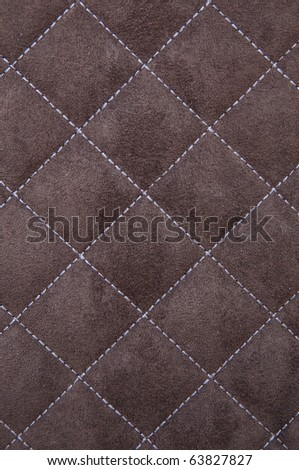 Brown suede leather with white criss cross stitching pattern - stock photo