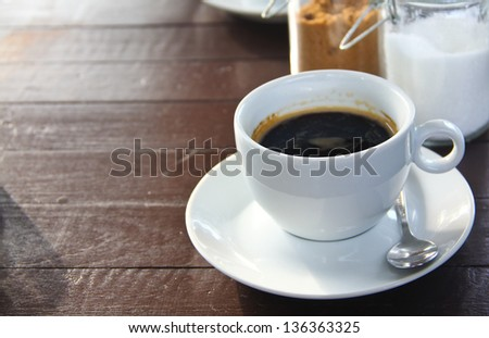 brown sugar and white sugar a cup of coffee on table - stock photo