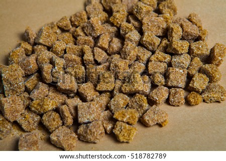 Brown sugar cubes for background. Top view