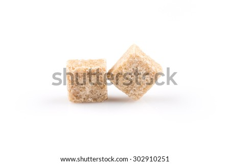 brown sugar cubes isolated on a white background - stock photo