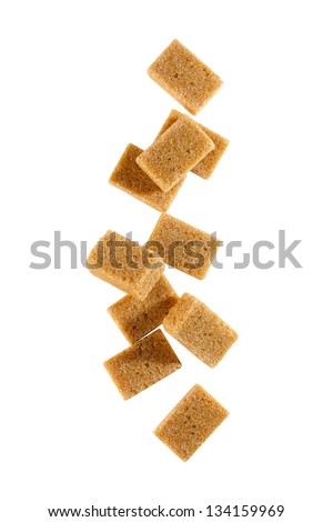 Brown sugar cubes. on white background - stock photo