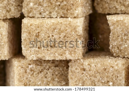 Brown sugar cubes shown their crystalline structure - stock photo