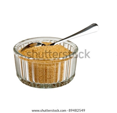 Brown sugar in bowl with spoon, isolated over white - stock photo