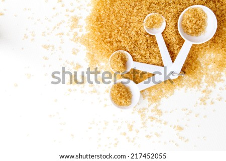 brown sugar in measuring spoon background - stock photo