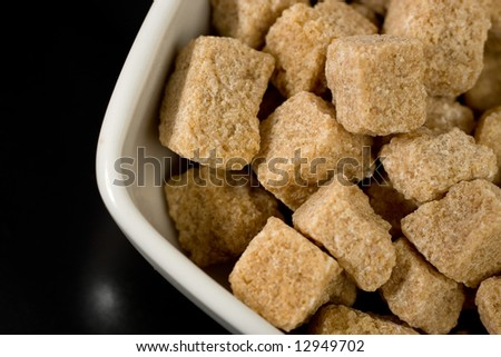 Brown sugar on white plate - stock photo