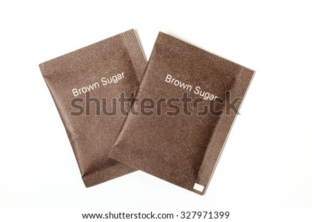 Brown sugar packet on white background  - stock photo