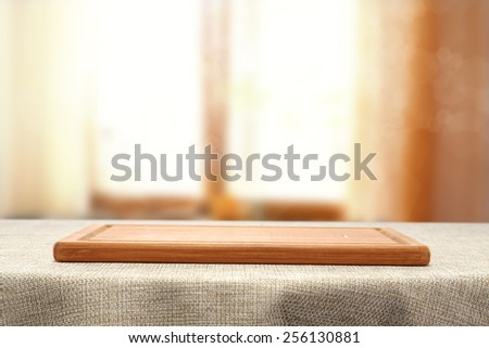 brown tablecloth and window space  - stock photo
